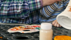 Father and son paint colors vase Stock Footage