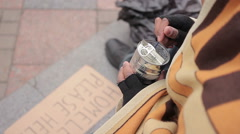 Socially vulnerable homeless person eating canned food in street, poverty issue - stock footage