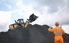 Coal Miner Instructing Digger Stock Photos