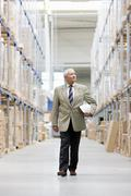 Man in charge in storage Stock Photos