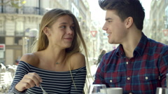 Couple on a date in a cute little Cafe - stock footage