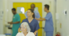 4K Portrait of smiling Asian medical worker in busy modern hospital Stock Footage