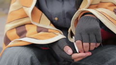 Closeup of poor panhandler's hands counting coins donated by sympathetic people Stock Footage
