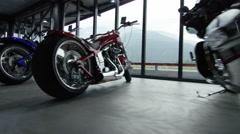 Walkthrough of a modern cool motorbike shop Stock Footage