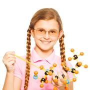 Girl in glasses with pointer and molecular model Stock Photos
