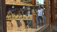 Strolling tourists, reflect on jewlery shop on Ponte Vecchio, Florence, Italy Stock Footage