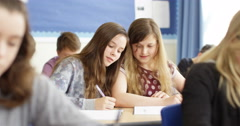 4k, Two students helping each other in a school classroom. Slow motion. Stock Footage