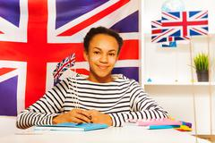 Teenage African student with flag of Great Britain - stock photo