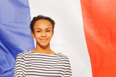 Beautiful African teenage girl with French flag - stock photo