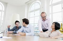 Group of people at a conference table - stock photo