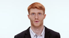 Handsome redhead man shocked Close up. Slow motion Stock Footage