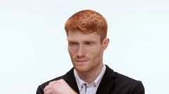 Handsome pensive redhead man reasoning . Close up. Slow motion Stock Footage