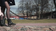 Slender legs of the girl, who was walking on park in black shoes Stock Footage