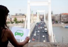 Woman holding paper green car Stock Photos