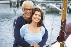 Middle aged couple on an old boat Stock Photos