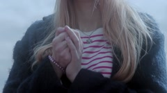 Teenage girl warming hands with breathing Stock Footage