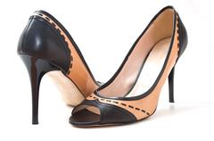 brown and black stilettos shoes on white background - stock photo