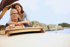 Middle aged couple on old boat Stock Photos