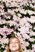 Woman laying down in the flowers Stock Photos
