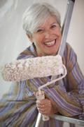Mature woman doing DIY - stock photo