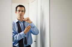 A business man doing up his cuffs Stock Photos