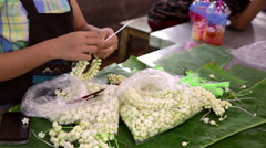 Temple flowers making at Bangkok market Stock Footage