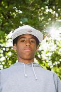 Black Teenager in a park with lens flare Stock Photos