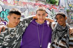 Teenage gang against graffiti wall Stock Photos
