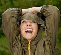 A woman with her arms up in the rain Stock Photos