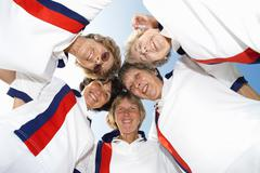 Female bowls players leaning over camera Stock Photos