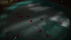 Crane shot of a Mexican Vintage round jacuzzi bathtub full of bubbling water Stock Footage