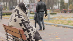 Mentally ill person hiding under blanket, happy people walking in autumn park Stock Footage
