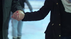 Lovers skating through crowd of Ice skaters at a public ice skating rink Stock Footage