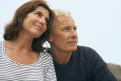 Middle aged couple head and shoulders - stock photo