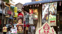 Indian movie posters at DVD shop Stock Footage
