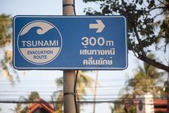 Tsunami evacuation sign in phuket - stock photo
