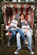 Young couple on beach chair Stock Photos