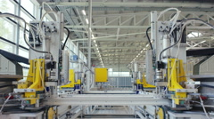 Machine in a production line assembling products Stock Footage