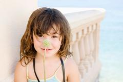 A portrait of a girl with plant stem - stock photo