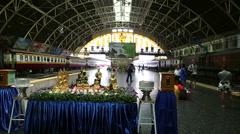 Bangkok train station Buddha shrine & trains Stock Footage