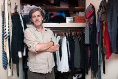 man in front of wardrobe - stock photo