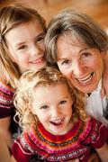 Grandma and grandchildren hugging Stock Photos