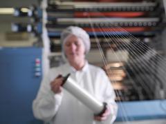 Technician Weaving Medical Product Stock Photos