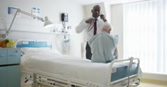 4K Friendly hospital doctor examining elderly patient in a private room Stock Footage