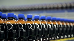 Bottles are moving on the tape conveyor Stock Footage
