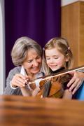Grandma teaching grandchild music Stock Photos