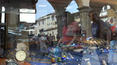 Strolling tourists, jewelry & watch shop on Ponte Vecchio, Florence, Italy Stock Footage