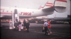 3317 people loading TWA passenger plane, then take off - vintage film home movie Stock Footage