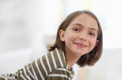 little girl smiling all over the face - stock photo