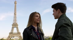 Young man proposes to his beautiful girlfriend with the Eiffel tower in the Stock Footage